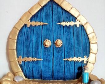 Large blue fairy door with bottle of magical fairy dust,  freestanding , handcrafted clay fairy door