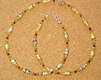 Handmade yellow recycled paper bead and golden crystal necklace