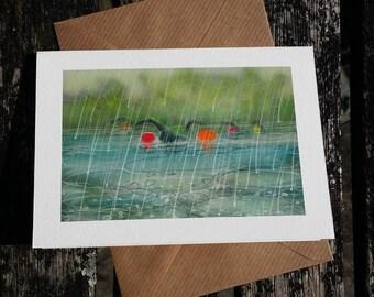 greetings card: 'Nice Weather for Rubber Ducks' - open water swimming, triathlon, wetsuit swimmers in the rain. Art by Nancy Farmer