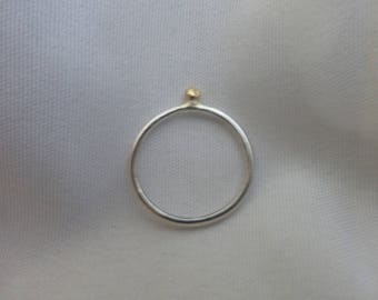 Delicate ring with 18ct gold ball sitting on the band