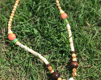Tassel and peach bead necklace