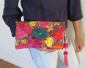 Clutch bag made by embroidered colorful flowers