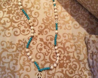 Ethno-chic necklace with peace symbol and black tassel