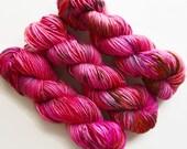 bubbles / hand dyed yarn / speckle yarn / superwash merino wool / squishy soft / single dk yarn /  red fuchsia pink purple yarn