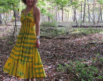 vintage smocked waist halter dress in bright yellow with ruffle bodice and tie back. size small or medium
