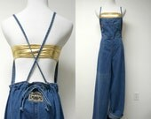 Pure Energy . 90s blue denim overall . medium . made in USA