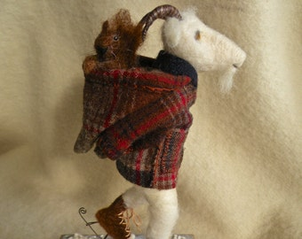 Cornelius takes Josephine for an afternoon skate. Needle felted goat and squirrel.