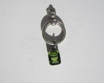 Sterling Silver Open Circle Pendant with Dangling Faceted Prong Set Emerald Stone       0754