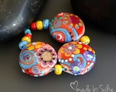 Reserved listing for K.     Handmade lampwork beads  l  lentil-shaped   l  Lightflowers  l SRA   l  glass set   l   made by Silke Buechler