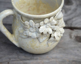Stoneware Tea Cup  in cream with three daisies  - Handmade  Stoneware Ceramics  - cream - mug
