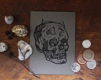 Skull postcard - linocut print on gray cardstock
