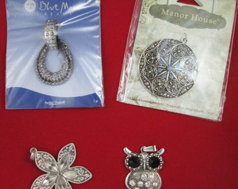 Lot of 4 Silver-Colored Metal Pendants