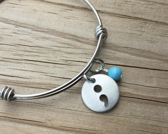 Semi Colon Bracelet- Bangle Bracelet with Semi-Colon Charm and an accent bead in your choice of colors- Hand-Stamped Jewelry