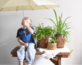 vintage off white umbrella with faux wood handle