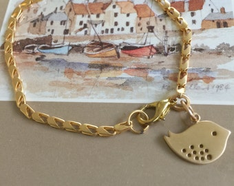 Gold Chain and Bird Bracelet