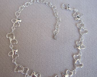 Petite Pairs of Silver Open Hearts with a Little Sparkling Crystals Linked Together