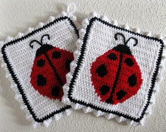 Ladybug Pot Holders. White, crochet and knit potholders with red and black ladybugs. Kitchen decor. Ladybird trivet