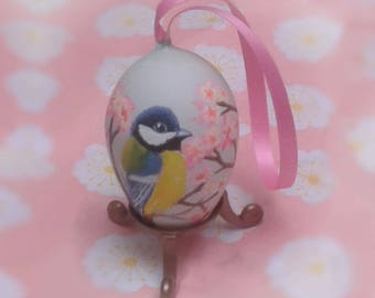 Bird & blossom painted egg. Spring / Easter ornament, with a miniature painting of a Blue Tit bird on the shell from a real egg.