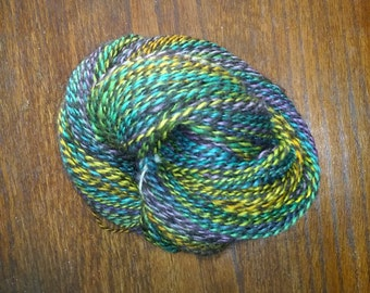 100% Wool, Hand Spun, 2-ply Yarn, Black and rainbow colors - 317 yds - sport/DK weight (sock weight) - 11 to 14 wpi