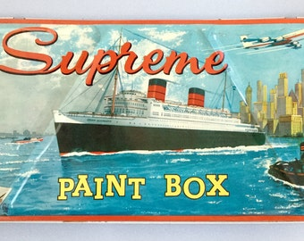Vintage The Supreme Childs watercolour paint set, Paint box, Queen Elizabeth ship New York skyline Statue of Liberty American Airlines plane