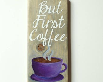 """12"""" tall wooden """"But first coffee"""" hand painted sign. With white lettering and multi-toned of purples on the coffee cup over a gray stain"""