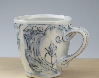 Thrown porcelain toile pattern mug with ornate handle