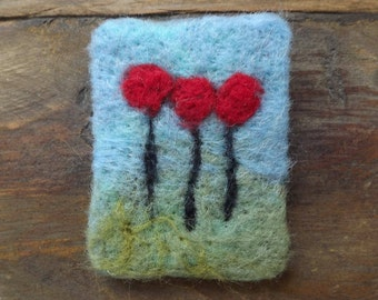 Needle Felted, Fibre Art Brooch of red poppies in a summers field