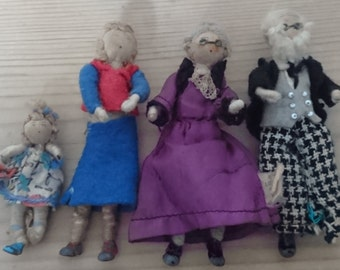 Four vintage Grecon dolls house dolls