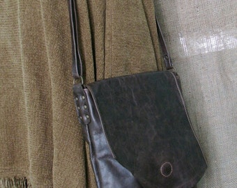 Leather crossbody bag with irregular flap