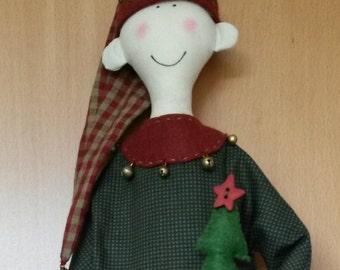 Hand-made doll Christmas elf with Christmas tree and gift
