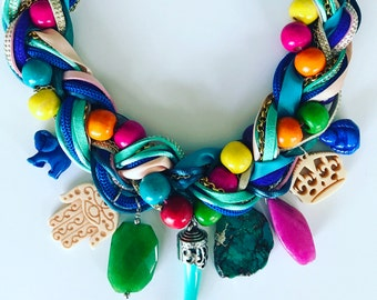 Color Necklace. Made with charmas, chains, leather, cords and wood beads.
