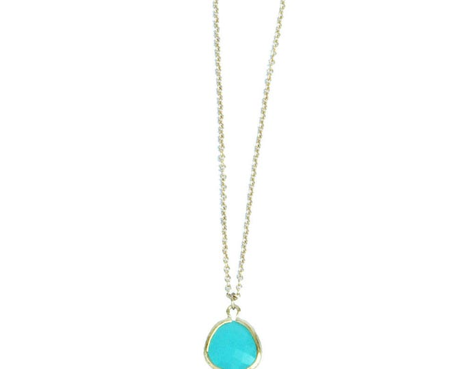 gold plated necklace with a round pendant and chain