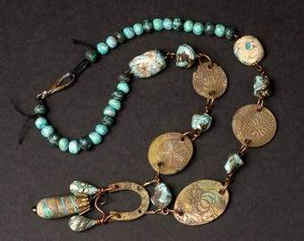 Squash Blossom necklace, a raw ceramic and antique iron horseshoe pendant with artisan clay and lampwork beads, boho turquoise and sky blue
