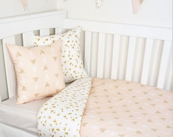 Blush and gold joining arrows nursery set items
