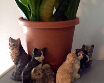 Cat family figurines.....Nicely detailed...realistic expressions....several colors