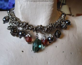 "vintage 27.1/2""silvertone metal necklace with heavily beaded front of assorted beads great condition"