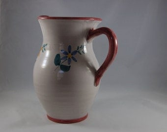 Water pitcher hand painted in italy, glazed pottery.