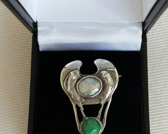 c1900 British Arts and Crafts sterling silver, mother-of-pearl and turquoise brooch with subtle fish design