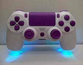 PS4 controller modified with colour changing LEDs , purple buttons and clear back