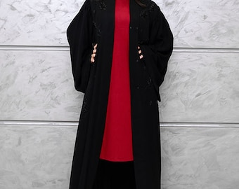 black abaya with pleated sleeves