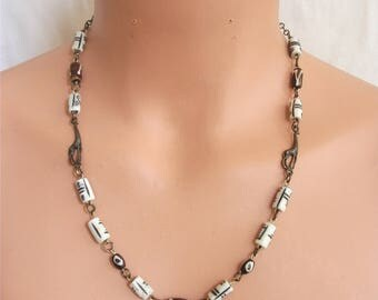 Tribal necklace with etched and batik beads.  Two giraffe