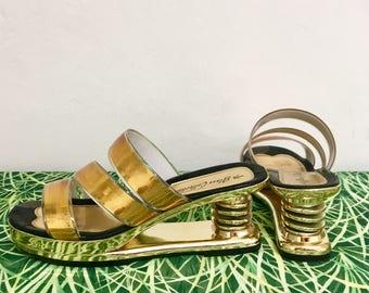 Super unique gold strappy spring heel sandal