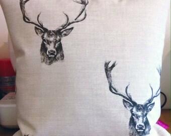 Stag print cushion.