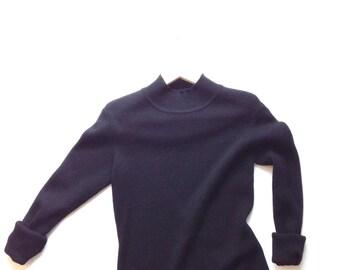 1990s Black sweater dress, 100% merino wool dress by jones & co. Size medium