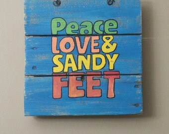 Peace Love and Sandy Feet hand painted sign on reclaimed wood