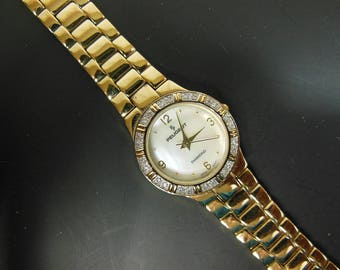 Peugeot Women's Round Goldtone Genuine Diamond Watch Mother of Pearl Face