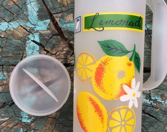 Vintage plastic lemonade pitcher with lid and handle yellow, orange and green lemons white flowers