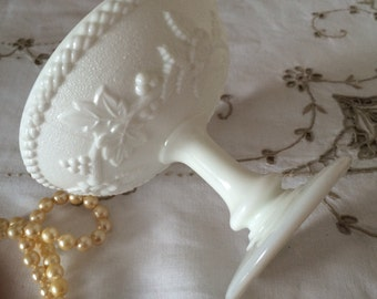 Vintage Milk Glass Pedestal Candy Dish with Raised Berry and Leaf Design.