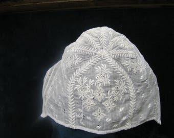 Victorian hand embroidered linen baby bonnet.circa 1840.