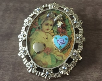 Golden broche with girl and hearts